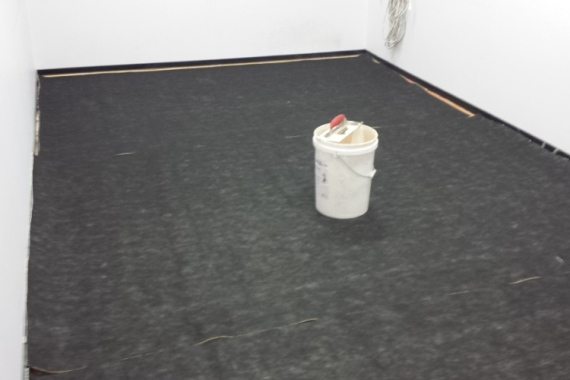 gluing of slab underlay prior to installation of carpet
