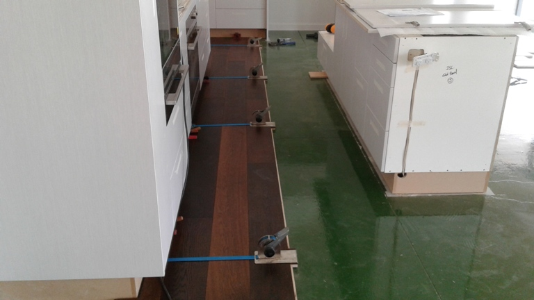 moisture membrane applied and inital installation of first 3 rows of engineered timber